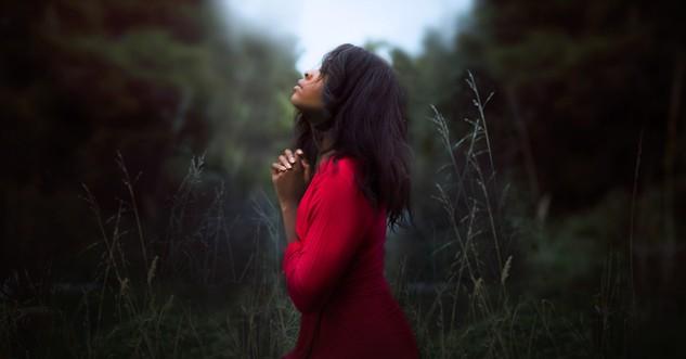 Woman praying outside