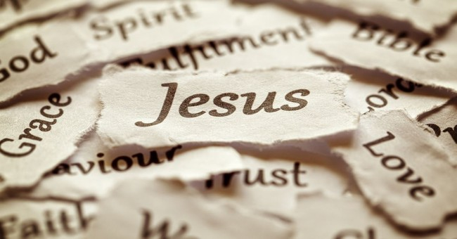 pieces of paper with words on them including Jesus, the name of Jesus
