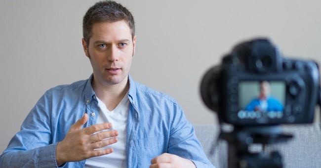 man talking into videocamera online church