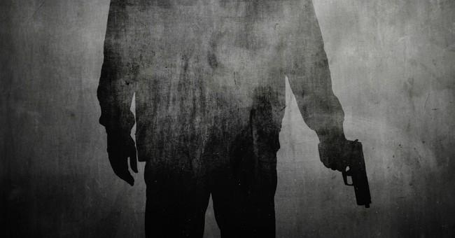silhouette of man holding gun violence murder justice