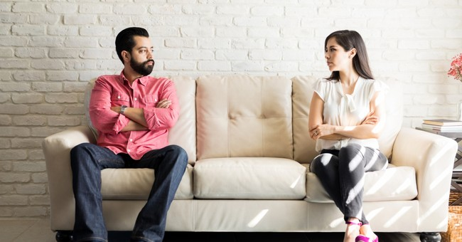 disputed couple staring at each other in disagreement