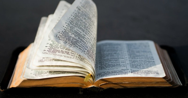 open Bible with pages turning