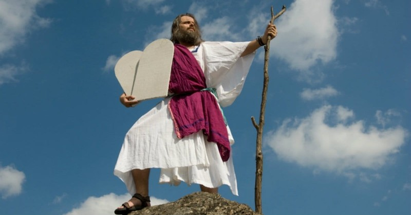 Moses holding tablets on mountain top