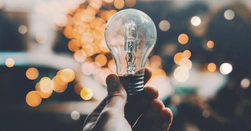 hand holding a lightbulb, light of the world