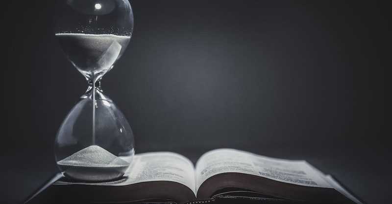 hourglass sitting on top of open Bible, end times and last days