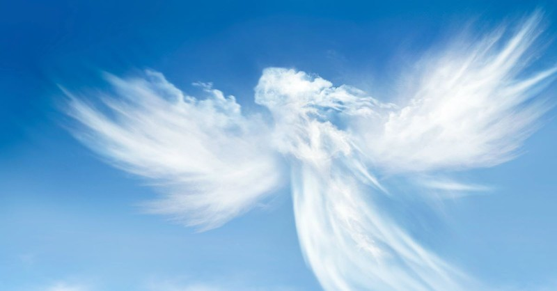 blue sky with cloud in form of angel