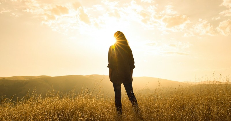 woman standing in field looking at sunrise, hunger and thirst for righteousness