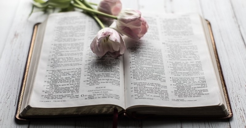 beautiful flowers sitting on top of open Bible, what does Kairos mean in the Bible