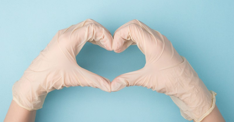gloved hands shaping a heart, seeing 2020 through new lens