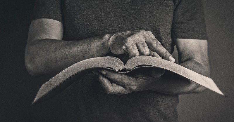 Pastor reading a Bible