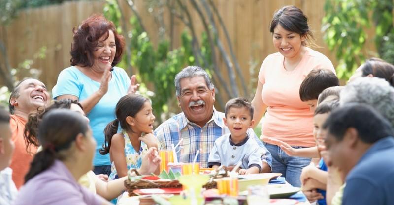 Big family enjoying dinner together