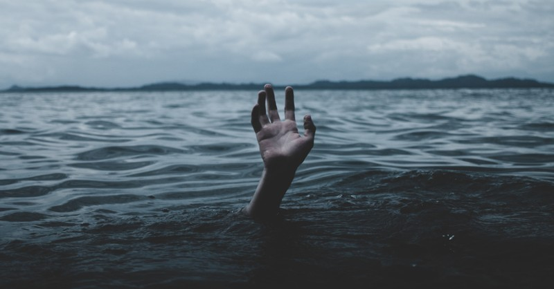 hand reaching out of the water