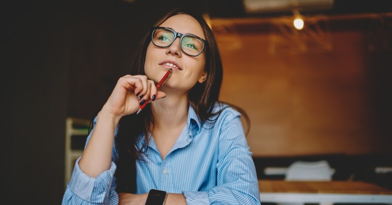 Young woman thinking while working