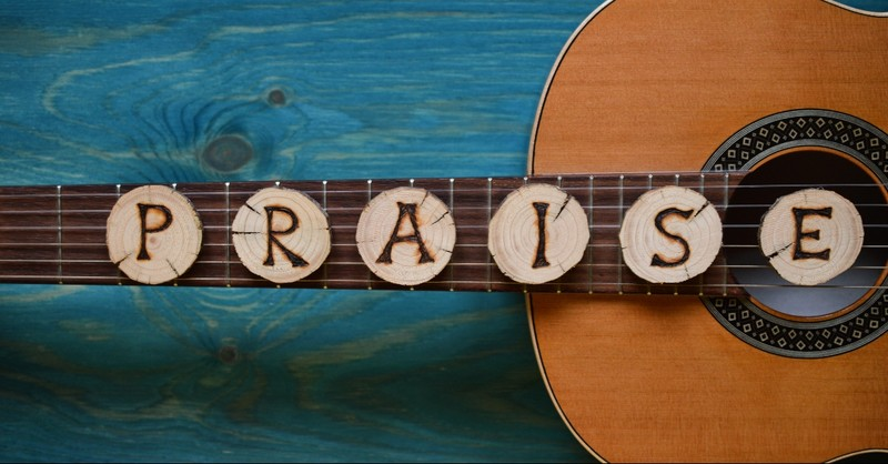 Guitar with the word praise on it