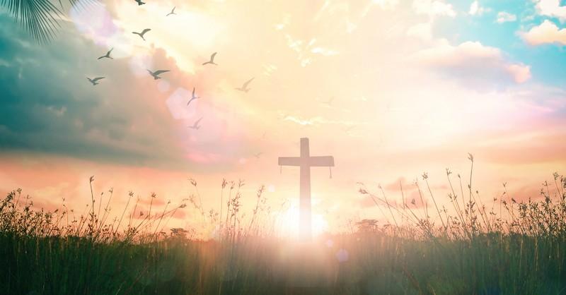 cross in hazy field Easter resurrection sunrise