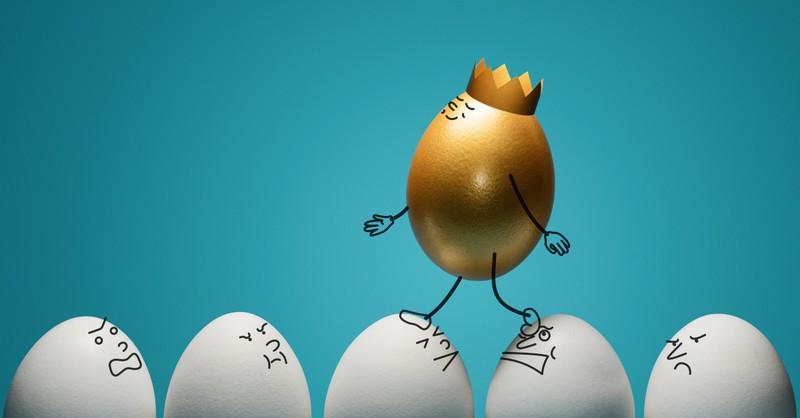 golden egg walking on white eggs conceit selfish