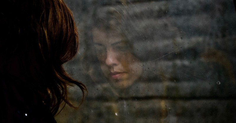 sad woman's reflection looking out of window with raindrops, a prayer of faith when there's no fight left in you