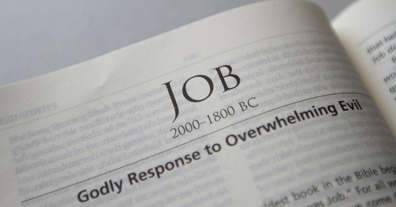 Bible open to book of Job, the story of Job