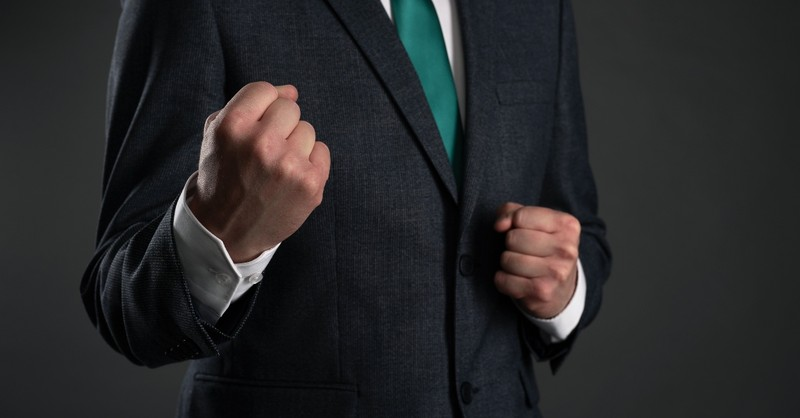 Businessman with his fists raised