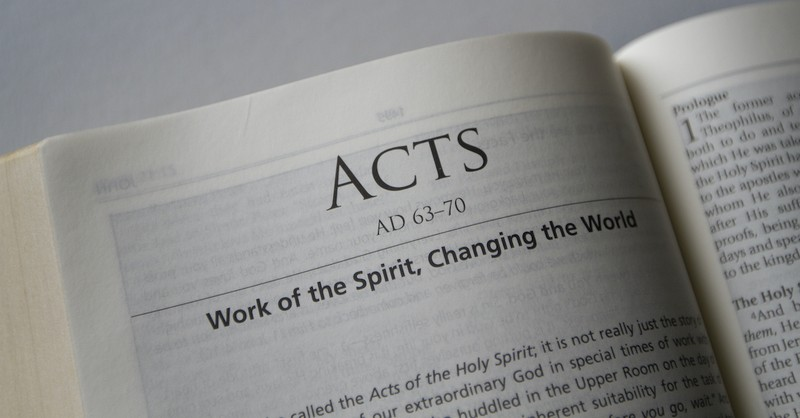 Bible open to Book of Acts, acts of the apostles