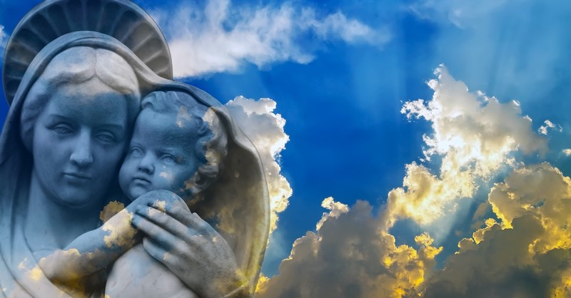 statue of Mary holding Jesus with blue sky background, the assumption of Mary