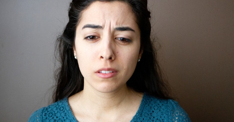 close up of woman with sad face about to cry, scriptures that call us to lament