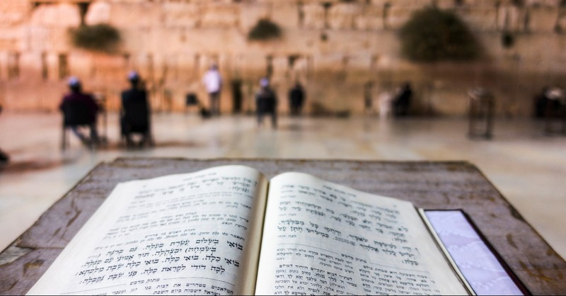 Torah opened in front of the Western Wall in Jerusalem