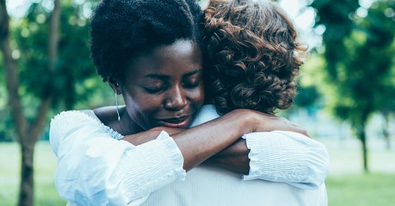 black woman hugging white man