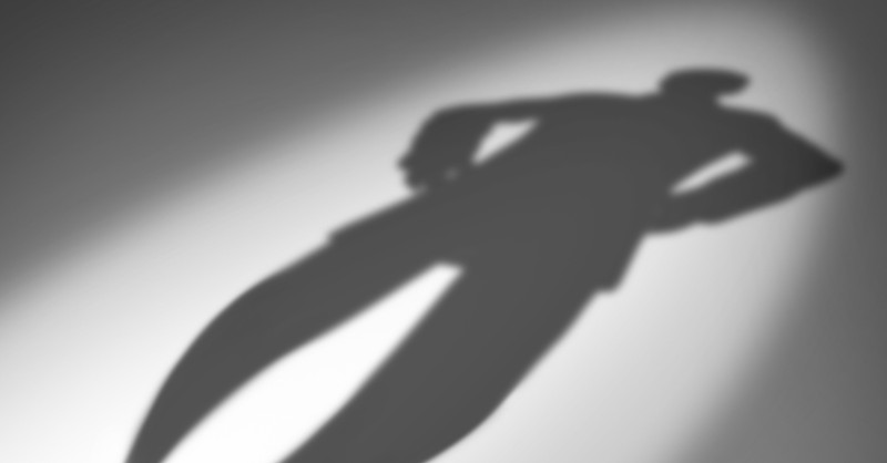 giant shadow of a man