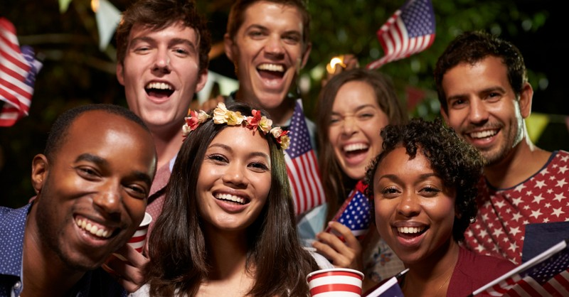 diverse multicultural friends gathering for fourth of july celebration