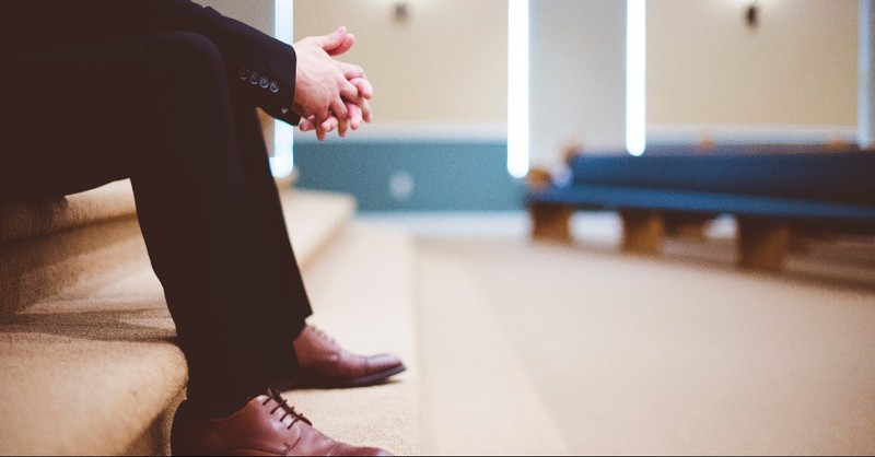 Shot of a pastor's hands and feet in a church
