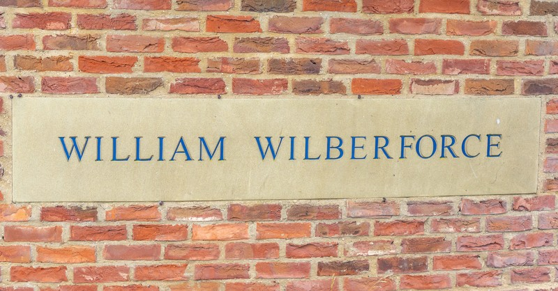 William Wilberforce name written on plaque across brick wall