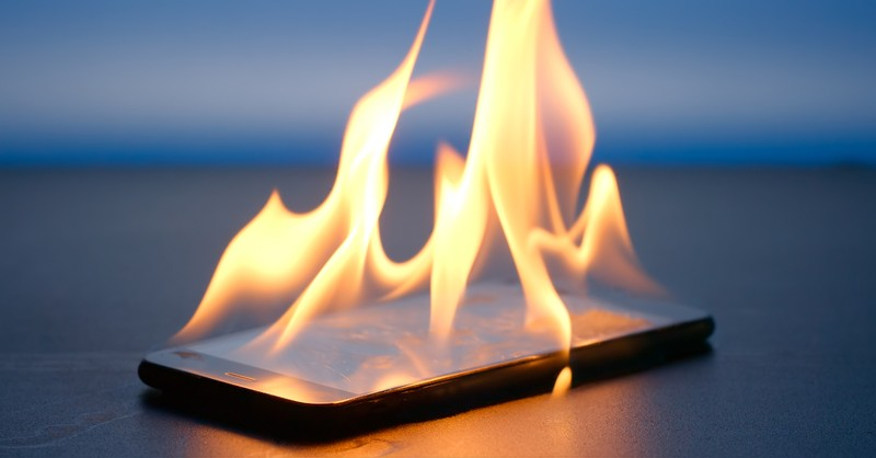 cell phone on fire satan social media