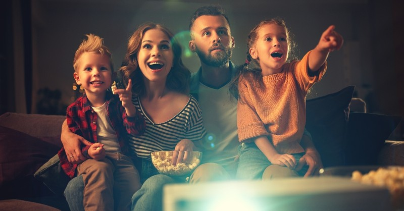 family watching a movie looking excited, classic family movies with gospel themes