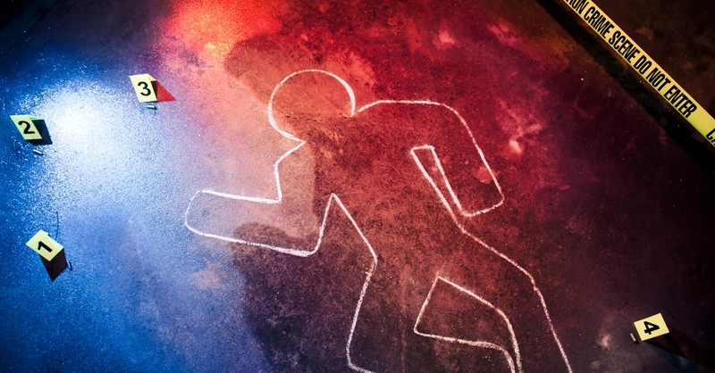 Chalk outline of a body at a crime scene - thou shalt not kill