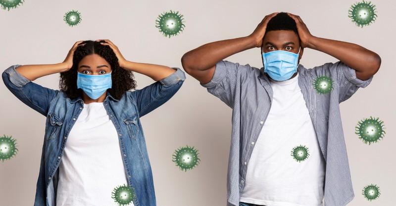 man and woman terrified hands on head face masks coronavirus vaccine mark of beast