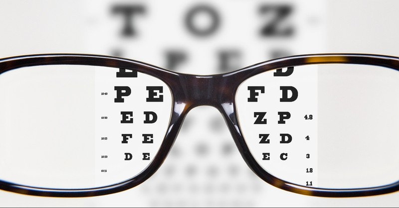Glasses looking through the eye test