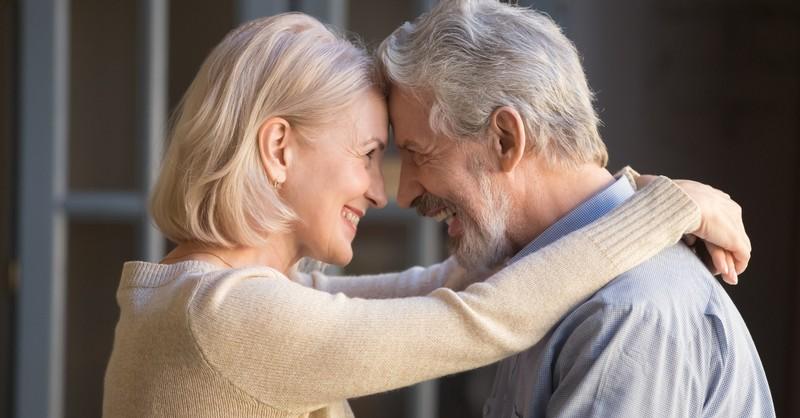 senior couple eye to eye foreheads together happy smiling