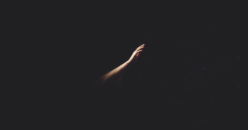 hand reaching out in darkness, how to move beyond shame into active love