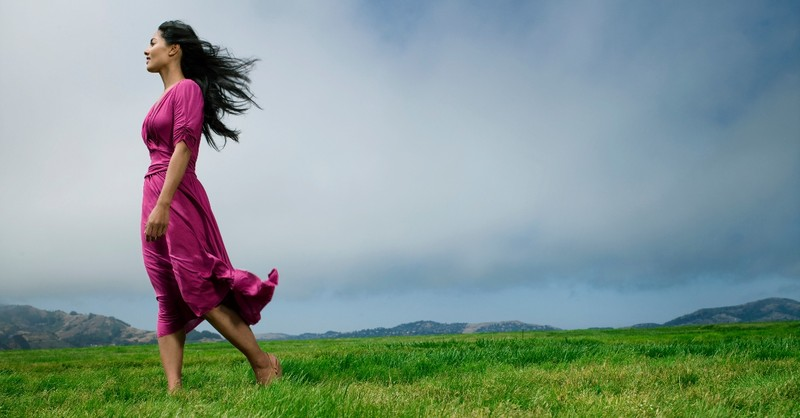 woman standing in flowing dress in field looking into the distance, prayers for hidden strength
