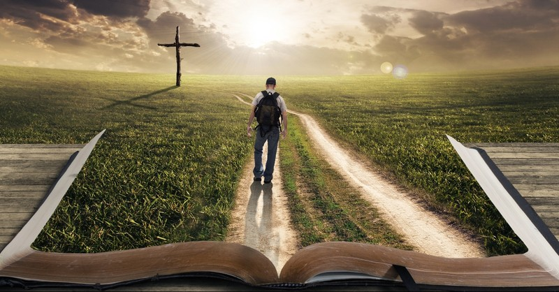 Bible Opened to a picture of a path to the cross