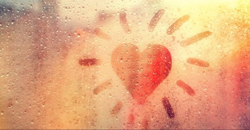 Heart drawn in a window mist