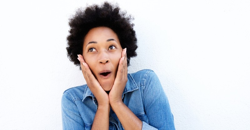 woman looking up amazed by the idea of Jesus returning