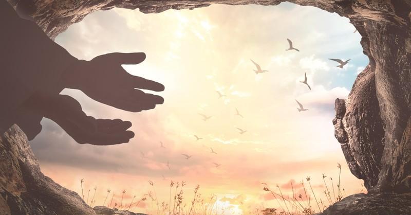 angel or Jesus hands in empty open tomb He Is Not Here for He Has Risen