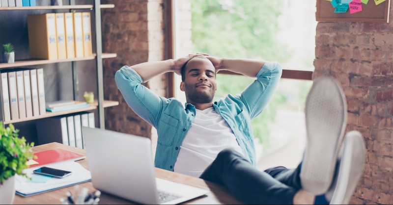 Man in an office reclining back