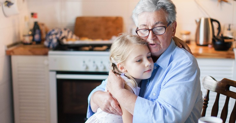 grandpa comforting their grandchild