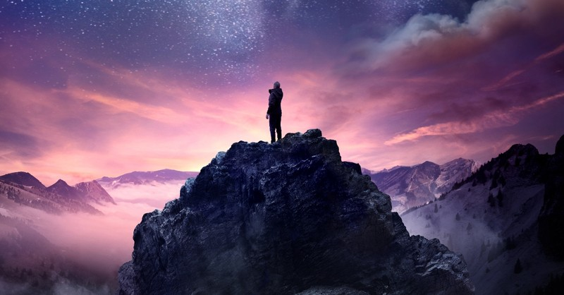person standing on rocky outcrop looking at beautiful universe, God will never leave you