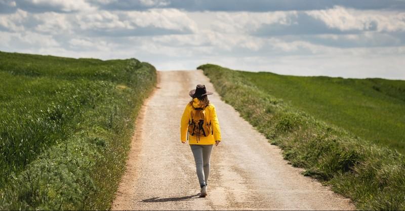 Woman walking a unknown path