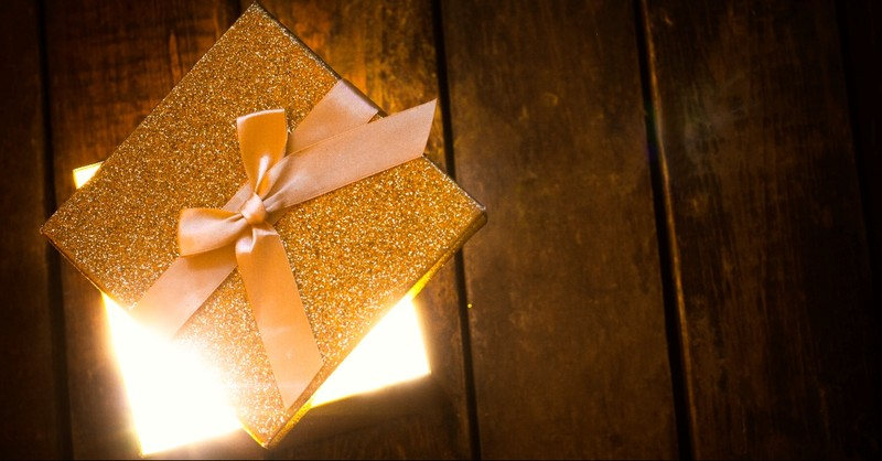 Golden Gift box with a blinding light coming out