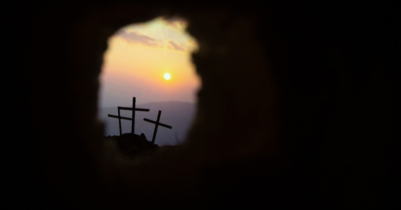 view from empty tomb looking at three crosses, he is not here for he is risen